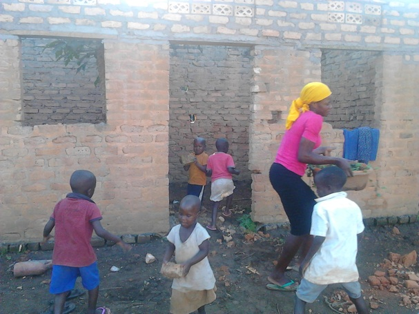 Teacher Edith with children at work