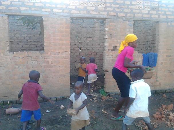 Teacher Edith with children at work